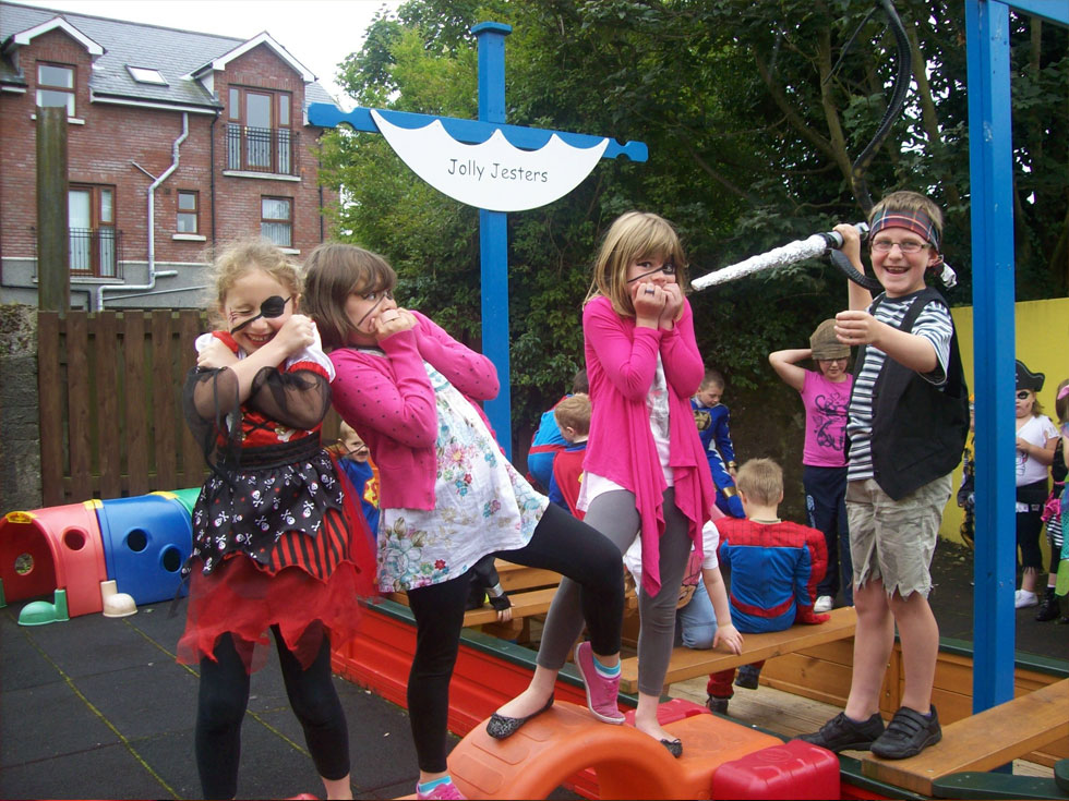 Children playing in playground at Jolly Jesters after-school service